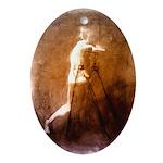 Figure erasing Oval Ornament
