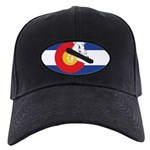 A Snowboarder in a Colorado F Black Cap with Patch