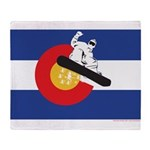 A Snowboarder in a Colorado Flag Throw Blanket