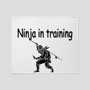Ninja in training Throw Blanket