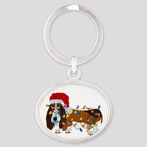 Basset Tangled In Christmas Lights Oval Keychain