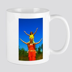 Girls with arms open Mugs
