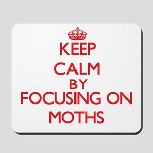 Keep calm by focusing on on Moths Mousepad