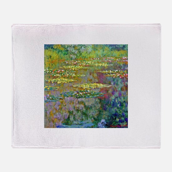 Water lilies by Claude Monet Throw Blanket