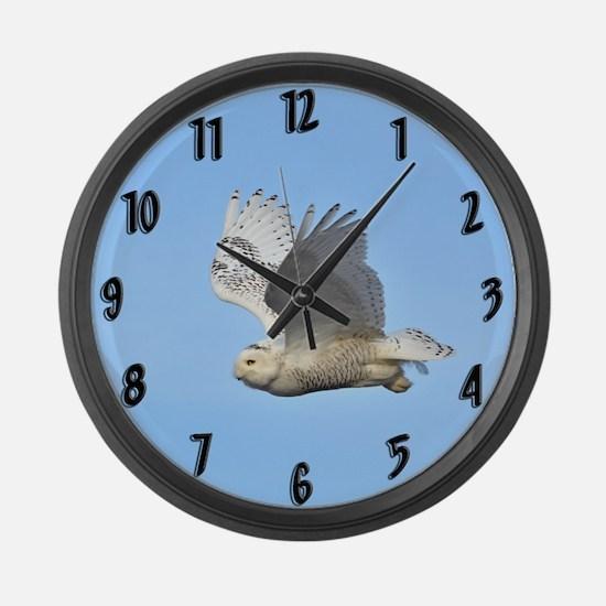 Snowy in flight Large Wall Clock