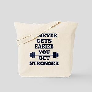 It Never Gets Easier You Get Stronger Tote Bag