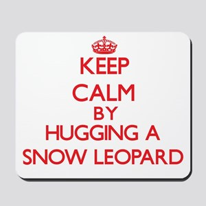 Keep calm by hugging a Snow Leopard Mousepad