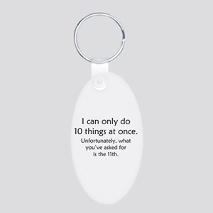 Ten Things At Once Aluminum Oval Keychain