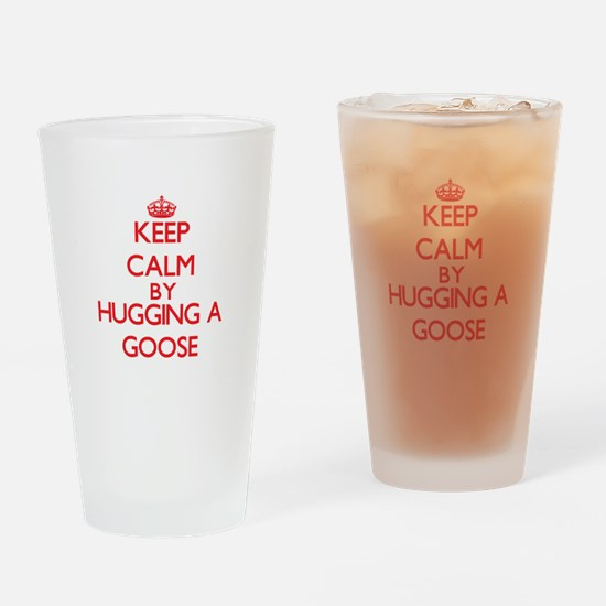 Keep calm by hugging a Goose Drinking Glass