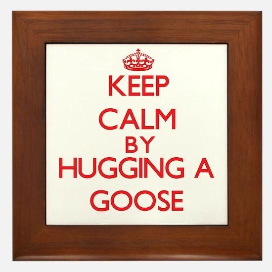 Keep calm by hugging a Goose Framed Tile