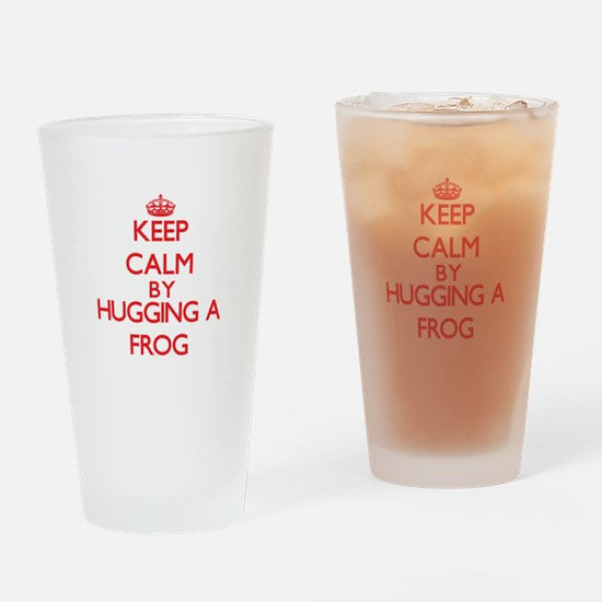 Keep calm by hugging a Frog Drinking Glass