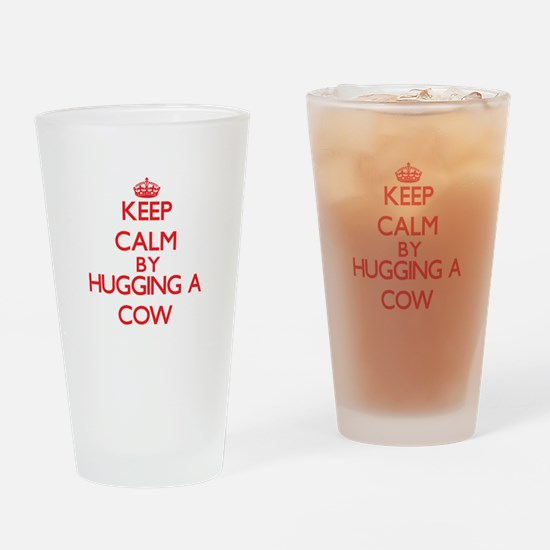 Keep calm by hugging a Cow Drinking Glass