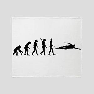 Swimming evolution Throw Blanket