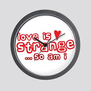 love is strange and so am I Wall Clock
