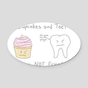 Cupcake vs. Teeth Oval Car Magnet