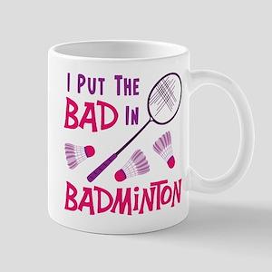 I PUT THE BAD IN BADMINTON Mugs