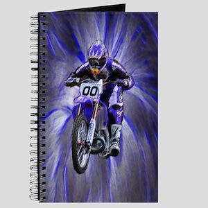 Dirt biker blasting thru blue Journal