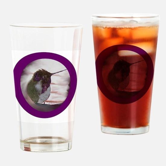 Hummingbird on Window Seal on Purpl Drinking Glass