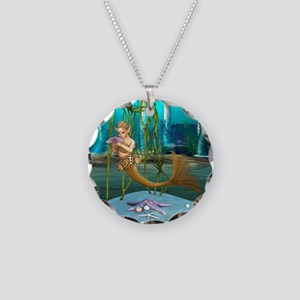 Little Mermaid holding Anemone Flower Necklace