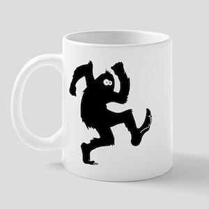 bigfoot outline Mugs