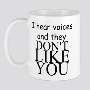 I HEAR VOICES AND THEY DON'T LIKE YOU!! Mug