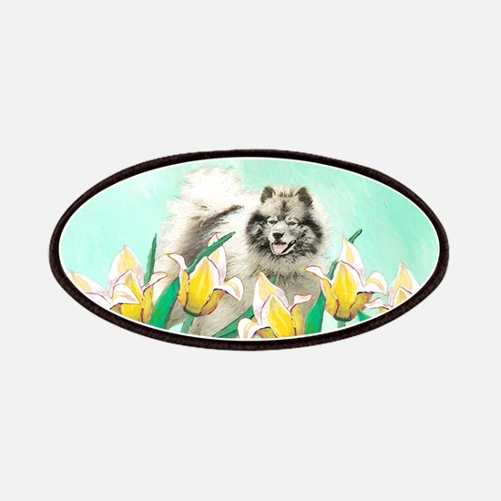 Keeshond in Tulips Patch