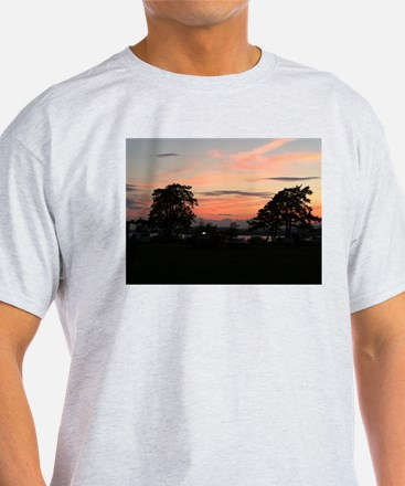 Sunset between the trees T-Shirt