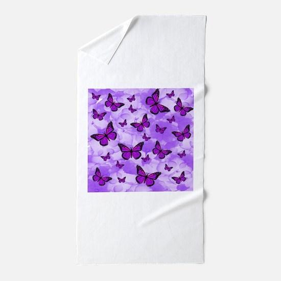 PURPLE FLOWERS AND BUTTERFLIES Beach Towel