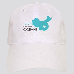 Love Crosses Oceans Baseball Cap
