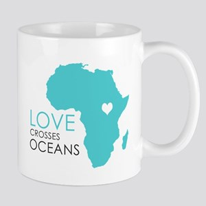 Love Crosses Oceans Mugs