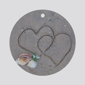 hearts and shells on sand Round Ornament