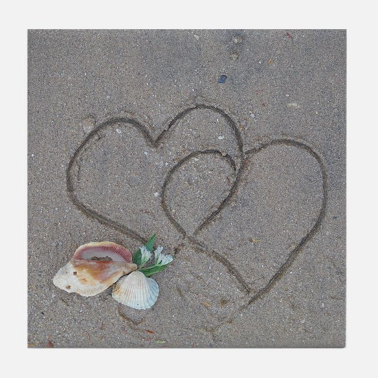 hearts and shells on sand Tile Coaster