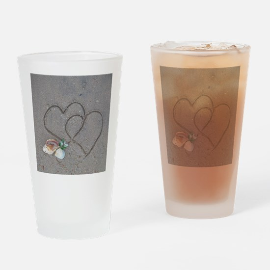 hearts and shells on sand Drinking Glass
