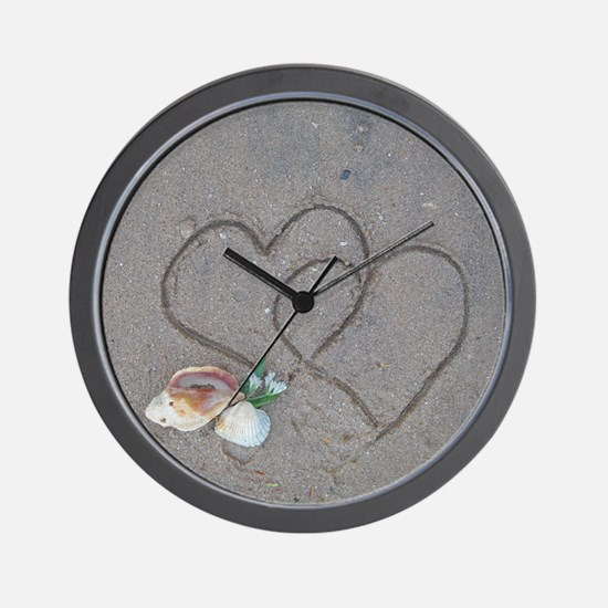 hearts and shells on sand Wall Clock