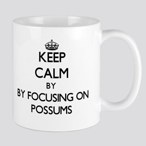 Keep calm by focusing on Possums Mugs