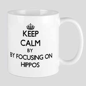 Keep calm by focusing on Hippos Mugs