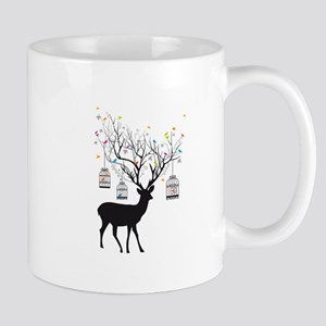 Deer with birds and birdcages Mugs
