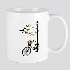Old vintage bicycle with tree Mugs