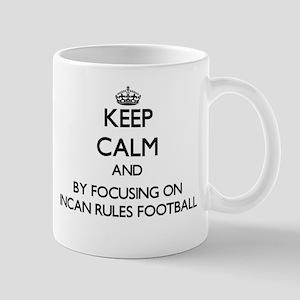 Keep calm by focusing on Incan Rules Football Mugs