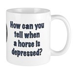 How do you know when a horse is depressed? Mug