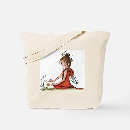 woodland fairy admires a rose Tote Bag