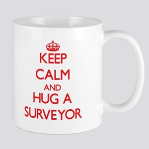 Keep Calm and Hug a Surveyor Mugs