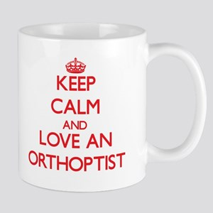 Keep Calm and Love an Orthoptist Mugs
