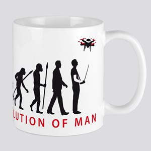 evolution of man controlling drone model Mugs