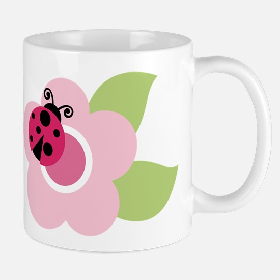 ladybug on flower Mugs