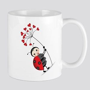 ladybug with heart tree Mugs