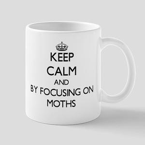 Keep calm by focusing on Moths Mugs