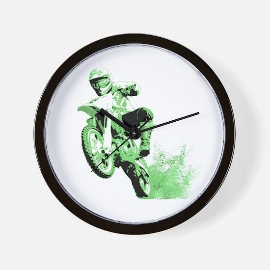Green Dirtbike Wheeling in Mud Wall Clock
