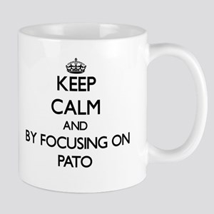 Keep calm by focusing on Pato Mugs