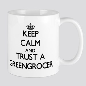Keep Calm and Trust a Greengrocer Mugs